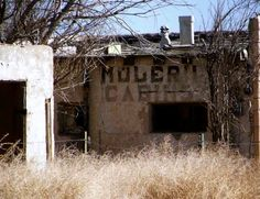 "Abandoned motel. Route 66 west of Albuquerque. ""Modern Cabins"""