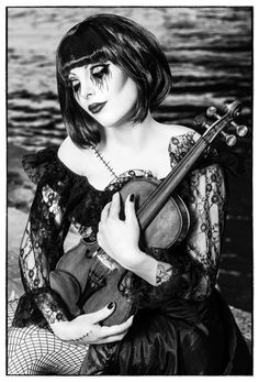 she is scary looing but I like the pose!  pictures with a violin