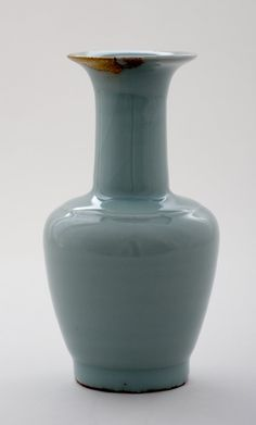 Longquan porcelain vase with long cylindrical neck. The vase has pale greyish green glaze. There is a single ridge at the shoulder. Southern Song dynasty 13th Century Longquan ware. The British Museum.