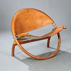 """Jørgen Høvelskov: An extremly rare """"Circle-chair"""" with folding frame of pine wood, metal fittings. Seat and back with thick patinated natural leather."""