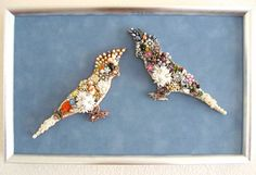 What a pretty pair of happy cockatiel! Hand layered with freshwater pearls, vintage rhinestones, Bakelite flower earrings, enamel, crystals and more make this beautiful creation. This framed piece measures 15 x 10 inches. Peaches & Cream are framed on light silvery blue matting with a brushed silver frame. What a wonderful one of a kind gift for the bird lover or tropical themed room!    Art Creations by CJ are one-of-a-kind vintage jewelry collage art & fashion creations ~ No two are...