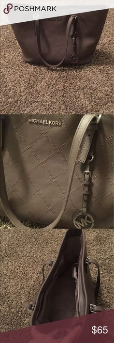 Michael Kors Purse Michael Kors purses carried for about 6 months. There is some peeling on the handles. Michael Kors Bags Shoulder Bags