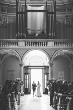 Black & White walking down the aisle | Photography by Lara Emme