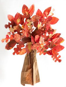 This would make a great preschool or elementary school classroom activity. have each child paint a sheet of paper in autumn colors using sponges, watercolors or finger paint, cut out leaves and then assemble on a paper bag tree trunk.