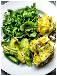 Egg, avocado & arugula breakfast sandwich with goat cheese & a toaste...