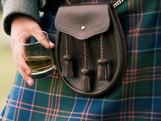 man in a kilt holds a glass of whisky. In 2014, Scotland will hold a ...