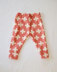 the softest leggings for your little one in a modern coral pink and cream design with a cuffed ankle.  these leggings offer a high quality braided elastic waist band to stretch with your little one as they grow.  all seams have been professionally serged to handle even the most frequent of wa...