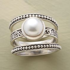 BOUNDARIES PEARL RING SET -- In this button pearl ring set, sterling silver beaded guard bands border a setting for a cultured button pearl. Set of 3 rings. Whole and half sizes 5 to 9.