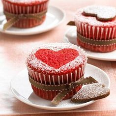 Red Velvet Cupcakes - Wear your heart on a decadent dessert. Red Velvet Cupcakes sport the color of the season. With a heart-shape cookie and a little powdered sugar, they're dressed for a party --. Valentine Desserts, Valentines Day Food, Valentine Day Cupcakes, Holiday Cupcakes, Heart Cupcakes, Valentine Treats, Valentine Heart, Winter Cupcakes, Valentines Baking