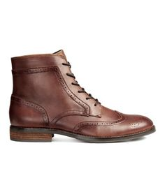 Dark cognac brown. Boots in imitation leather with a brogue pattern. Lacing at front, canvas lining, and canvas insoles. Rubber soles. Heel height 1 in.