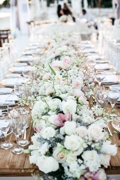 The bride's favorite arrangement was the trailing floral runner that included alabaster, pink, and peach roses, ivory hydrangeas, and greenery that adorned the head table. #receptiondecor #beachwedding #floralrunner #tablerunner Photography: Stephen Karlisch. Read More: http://www.insideweddings.com/weddings/elegant-beachside-destination-wedding-in-playa-del-carmen-mexico/663/
