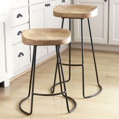 Smart and Sleek Stool. An all natural, sleek, wood top stool with a skillfully designed, minimalist metal base. Unfinished oak and metal construction. Sleek, modern style. Combines form and function