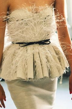 feathered peplum//pretty, but feel I would be (phffft) fighting feathers all night...