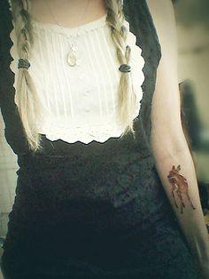 Deer tattoo on the forearm