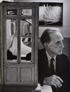"""Duchamp with Door Sculpture, Duchamp Retrospective, Pasadena Art Museum, 1963 vintage gelatin silver print 13.5 x 10.5"""" © Julian Wasser"""
