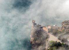 Swallow's Nest in Yalta, Crimea. Aerial view - The Swallow's Nest is a decorative castle located at Gaspra, a small spa town between Yalta and Alupka, on the Crimean Peninsula. Beautiful Castles, Beautiful Places, Beautiful Scenery, Amazing Places, Station Balnéaire, Château Fort, Mysterious Places, Mont Saint Michel, Scenic Photography