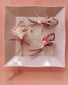 For this California wedding, boutonnieres made of pink nerines are tied with silk ribbon. Each is pinned to a knot of Mizuhiki cord, created using a Japanesse knotting technique believed to bring the recipient good luck.