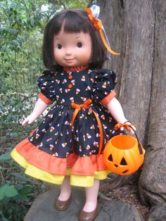 Halloween cute. Like the 2 tiered ruffle & tiny pumpkin