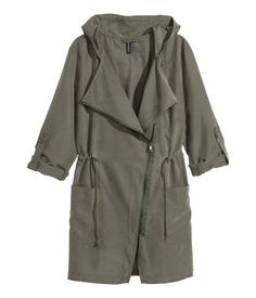 Khaki green parka with diagonal zip, drawstring waist, and hood. | Warm in H&M