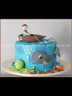 Boat cake - make with toy skiff & fisherman on top and just outline fish in frosting on sides