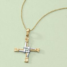 "Women's 14 Kt. St. Bridget's Cross with Diamond Necklace.  ""Though a Christian symbol, it possibly derives from the pagan sunwheel. It is usually made from rushes or, less often, straw. It comprises a woven square in the centre and four radials tied at the ends ... ""It was traditionally believed that a Brigid's Cross protects the house from fire and evil."""