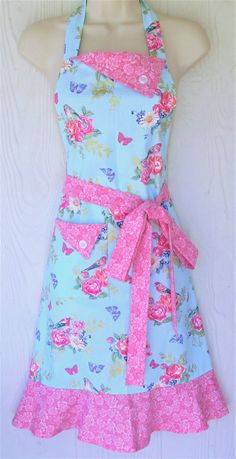 Floral Apron, Spring Motif Apron, Birds, Butterflies, Flowers, Pink Roses, KitschNStyle  This womens retro full apron is a floral motif in beautiful, bright Spring colors with a gorgeous variety of butterflies, birds and bouquets of flowers - all against a sky blue background.  Accent pieces are a coordinating print of pink roses.  Ties are extra long to fit and flatter many body types and sizes. A sturdy, lined pocket in the front makes this apron perfectly practical for daily use…