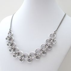 This simple chainmaille necklace would look beautiful on women of all ages. The fresh and elegant style would look fabulous dressed up or down. Large aluminum jump rings are connected with small jump