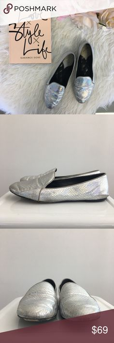Holographic Silver Snakeprint 'Claudelle' Loafers B Brian Atwood loafer flats in a holographic silver snakeprint. Definite wear and scuffs, but the color and texture do a great job at disguising while on. Priced accordingly. Comes with box and dust bag. Please carefully review each photo before purchase as they are the best descriptors of the item. My price is firm. No trades. First come, first served. Thank you! :) B Brian Atwood Shoes Flats & Loafers