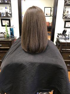 Medium length brown hair No layers