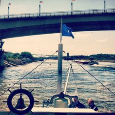 Following a towboat up through the Robert and Wabasha St. bridges in Downtown St. Paul. Mississippi River.