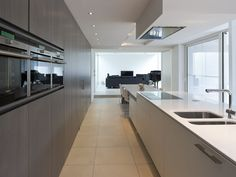 :: KITCHENS :: Photo Credit: Belgium based Cocoon Architecten -LOve but fear the affect on traffic patterns.Thats a long walk to sliding door to let pets out or get to the grill. Modern Interior Design, Interior Architecture, Grand Kitchen, Kitchen Modern, Open Kitchen, Kitchen Interior, Kitchen Design, Elegant Kitchens, Construction