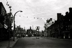 Coronation day 1952, local Scouts camping in Leighton Buzzard High Street by the Market Cross as part of the celebrations