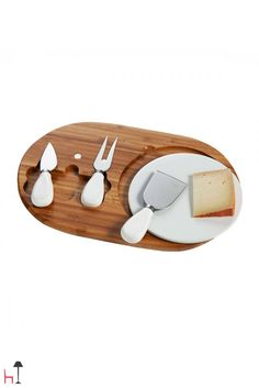 This set by Brandani includes a bamboo tray, a porcelain cutting board, a parmesan cheese knife, fork/knife for mature cheese, knife for soft cheese.