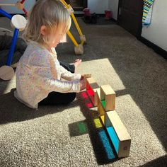 Montessori at home: Making the most of the ☀️ today! Montessori toddler at work with rainbow blocks