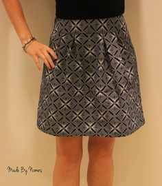 Handmade Shwe Shwe Cotton Pleated above the Knee Skirt with side zipper. Size UK 10/S on Etsy, £45.00 The fabric is an indigo blue with white and yellow geometric repeating patterns, it almost looks like it is sparkling! Fabric is from South Africa