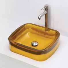 DECOLAV's Incandescence 2802-HNC Rectangular Above-Counter Resin Lavatory offers a unique rectangular eye-catching shape featuring a gently sloped basin and wide rim. Available in seven brilliant colors.