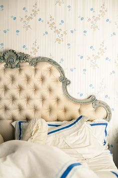 Kind of a hard colors to work together but the blue really makes everything balanced. LOVE the headboard!