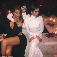 A lot of leg: The girls posed with half-sister Khloe Kardashian who wore a plunging black ...