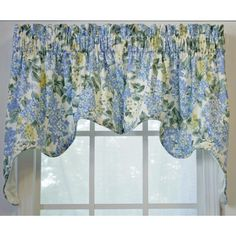 Give any room a romantic touch with this two-piece floral swag valance. The rod pocket-designed valance is constructed from 100 percent quality cotton and features beautiful blue and yellow hydrangea flowers set on an off-white background.