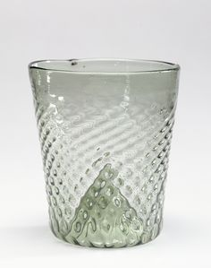 Beaker (Maigelbecher); Unknown; Germany; 1450 - 1525; Mold-blown pale blue-green glass; 8.7 x 8.3 cm (3 7/16 x 3 1/4 in.); 84.DK.523