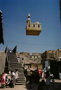 harry gruyaert(1941- ), egypt. cairo. 1987. old district of the city. during the ramadan. a miniature mosque hangs over the street. http://www.magnumphotos.com/C.aspx?VP3=SearchDetail&VBID=2K1HZOQPGS0GEZ&PN=2213&IID=2S5RYD1CHK9E