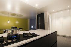 Black and white kitchen (white composite + black oak wood) Neff & ATAG appliances.