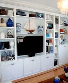 Built-in bookcases with TV - love the bookcase styling