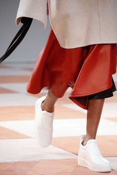 Felt poncho, leather skirt, white sneakers at Céline Fall 2015