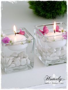 A small glass wind light filled with white gravel and a white floating core . A small glass wind light filled with white gravel and a white floating candle. You can fill the glass with water and decorate it with small flowers ar. Living Room Candles, Bedroom Candles, Floating Candle Centerpieces, Diy Candles, Diwali Decorations, Wedding Decorations, Table Decorations, Home Crafts, Diy Home Decor