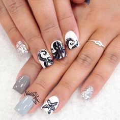Black nails art is super classy and totally sexy. You can paint your nails shiny black and add some bold color for a French tip. Or you can add gemstones so that your nails sparkle in the sunlight! Check out these totally awesome ideas for black nail designs! #nails #nailart #naildesign #nailscolor