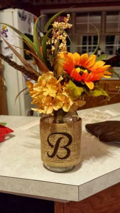 "Could do mason jar with burlap around it with ""F"" then fill with wedding flowers for centerpieces"