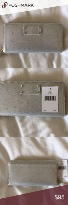 NWT (Kate Spade neda wallet, silver Kate spade metro neda zip wallet. Patent leather with delicate heart punches. WLRU1444 This continental wallet zips around to stow train tickets, movie stubs, and all the cash or credit you'd ever need to carry in its plentiful pockets and slots. Fits the largest iPhone plus.  -Continental wallet embossed pvc with patent pvc trim -kate spade new york license plate. -Back exterior slip pocket. Zip around closure. -Center zip change pocket, 3 bifolds, 12…