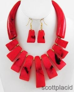 """CHUNKY RED RESIN CORAL GOLD TONE METAL NECKLACE SET     * If you need a necklace extender I have them for sale in my store.*     NECKLACE: 15 3/4"""" + EXT    HOOK EARRINGS: 2 1/8"""" LONG    DROP: 3"""" LONG    COLOR: GOLD TONE $27.99"""