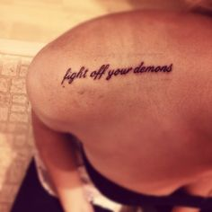 "fight tattoo | Fight off your demons"" small quote tattoo on a girls shoulder in ..."